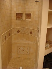 pentagon shower stall with porcelian tile sit down bench rescessed tile pockets and custom inlay